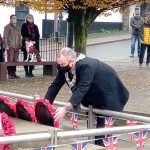 Caerphilly Town Mayor laying a poppy reef at Caerphilly Cenotaph